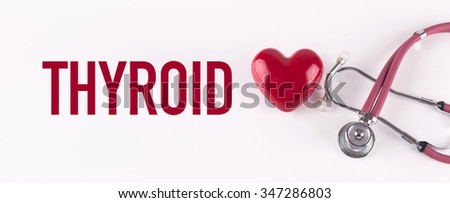 THYROID concept with stethoscope and heart shape - stock photo