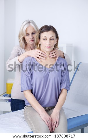 Thyroid Palpation Woman patient  - stock photo