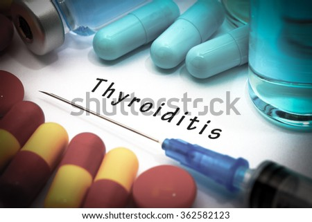 Thyroiditis - diagnosis written on a white piece of paper. Syringe and vaccine with drugs. - stock photo