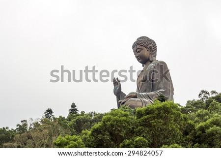 Tian Tan Buddha (the Big Buddha) is a large bronze statue of a Sakyamuni Buddha and located at Ngong Ping Lantau Island in Hong Kong. - stock photo