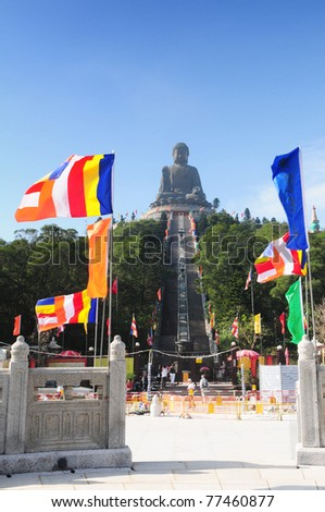 Tian Tan Buddha - The worlds's tallest bronze Buddha in Lantau Island, Hong Kong, China with colorfull flags - stock photo