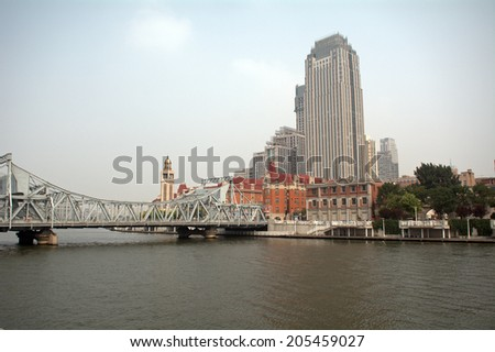 TIANJIN, CHINA - JUNE 17 : Tianjin city center on 17 June 2014. at Tianjin, China. Tianjin is one of the fastest developing city in China. - stock photo