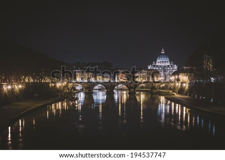 Tiber River and St. Peter's Basilica at night - stock photo