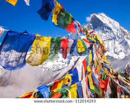 Tibetan Flags at Annapurna Base Camp 4200m (Himalaya, Nepal) - stock photo