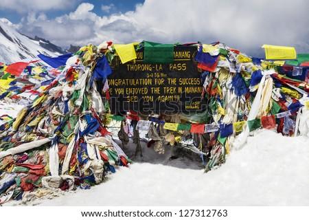Tibetan flags at Thorong La pass - stock photo