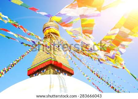 Tibetan flags in Boudhanath Stupa, Nepal - stock photo