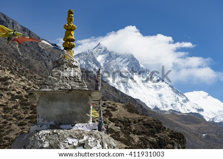 tibetan Prayer flag and stupa  on the top of Chukung ri with Lhotse (8516m) - from Dingboche Mt. Everest region Nepal - stock photo