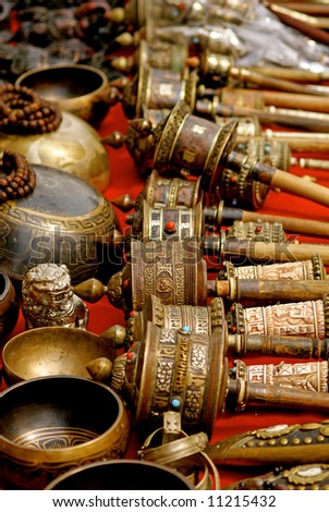 tibetan prayer wheels and other things - stock photo