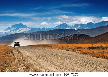 Tibetan road and mount Everest on background - stock photo