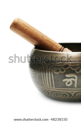 Tibetan singing bowl isolated on white - stock photo