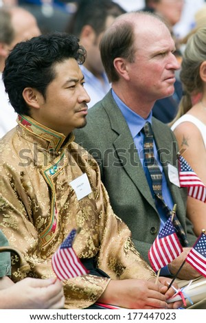 Tibetan with new American citizens at Independence Day Naturalization Ceremony on July 4, 2005 at Thomas Jefferson's home, Monticello, Charlottesville, Virginia. - stock photo