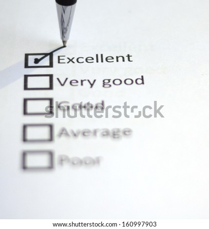 Tick placed in Excellent - stock photo