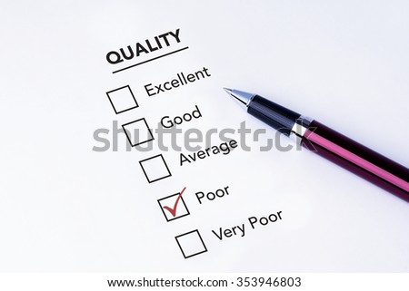 Tick placed in poor check box on quality service satisfaction survey form with a pen on isolated white background. Business concept survey. - stock photo