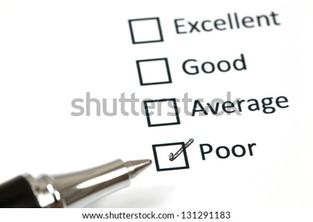 Tick placed in poor checkbox - stock photo