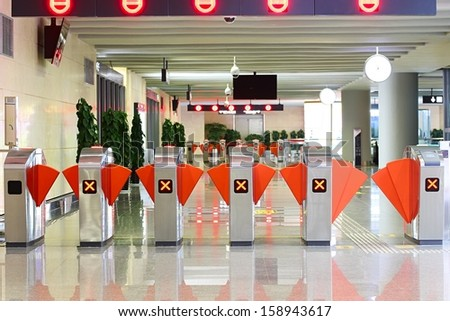 Ticket checkers at entrance of subway station. - stock photo