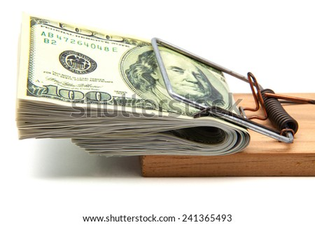 tickets for hundred dollars in a mousetrap - stock photo