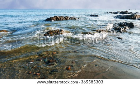 Tide comming in on a beautiful tropical beach at Pedasi, Panama. - stock photo