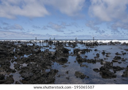 tide pools with lava rocks - stock photo