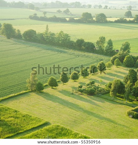 tidy square - view over the early summer green fields from the air; East Anglia; UK - stock photo
