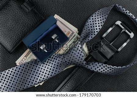 Tie, belt, wallet, cufflinks, money lying on the skin, can be used as background - stock photo