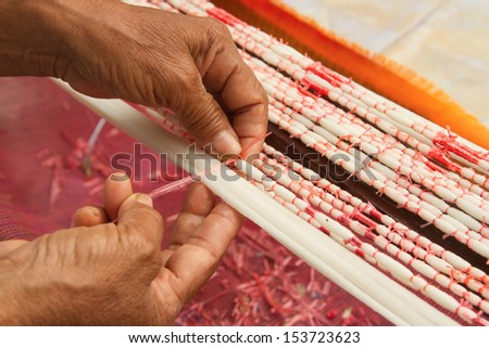 Tie dye technique of threads before weaving clothes at Asian textile handmade - stock photo