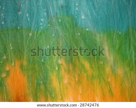 Tie-dyed Fabric in blue, green and yellow 2 - stock photo