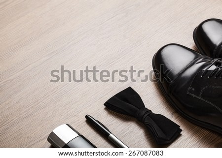 Tie. Men accessories on the brown wooden table - stock photo