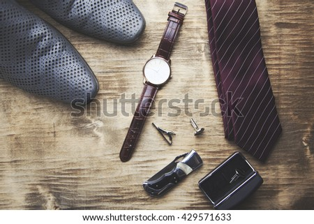 tie, shoes and watch on wooden table - stock photo
