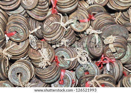 Tied ancient Chinese coins - stock photo