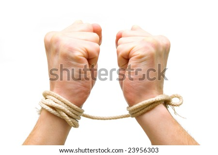 Tied hands on white background - stock photo