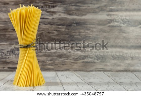 Tied spaghetti ready for cooking - stock photo