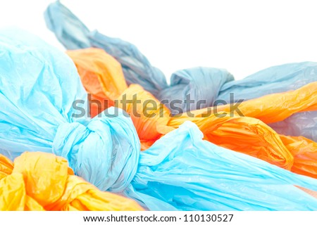 Tied up plastic bags on a white background - stock photo