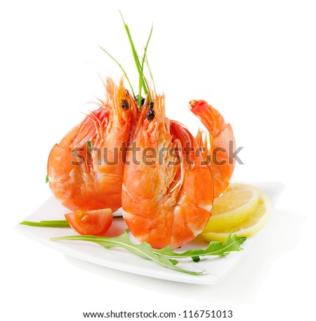 Tiger shrimps with fresh vegetables isolated on white - stock photo