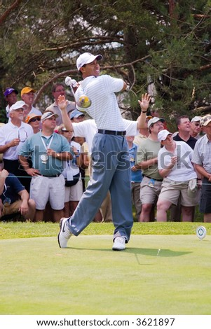 Tiger Woods drives the ball at the 2007 Memorial Golf Tournament in Dublin Ohio.  This is the fifth shot in a six shot series. - stock photo