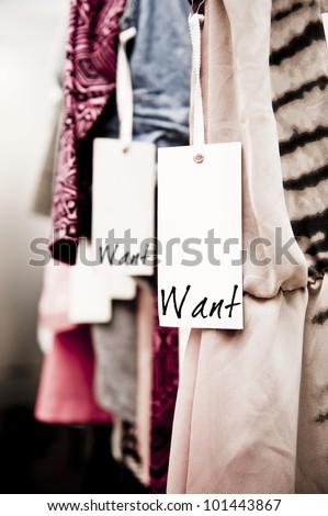 """tight crop of clothes in a boutique with a tag reading """"want"""" - stock photo"""