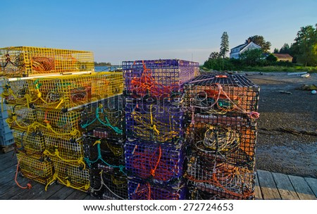 Tight shot Lobster Pots on fishing wharf of Owls Head Marina in Owls Head fishing village in Maine at low tide. - stock photo