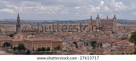 Tight shot of the central part of the Toledo (Spain) with Cathedral and Alcazar - stock photo