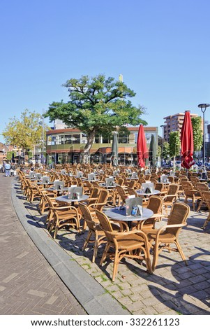 TILBURG-HOLLAND-OCTOBER 1, 2014. Rattan seats outdoor at Pius Square, located in Tilburg downtown area. The square is a popular place to have sociable meetings, especially during the summer months.  - stock photo