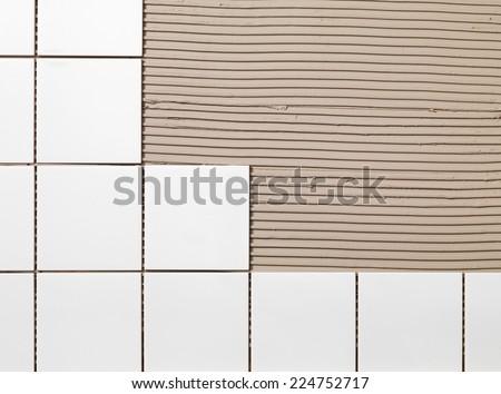 Tile Adhesive and tiles - stock photo