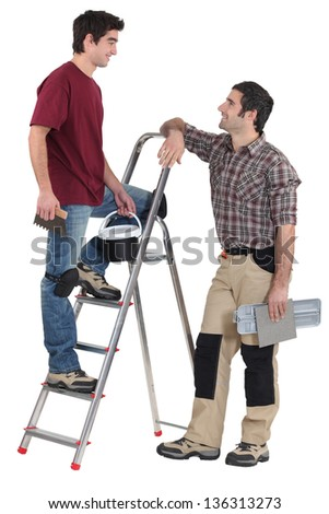 Tile fitters having a conversation - stock photo