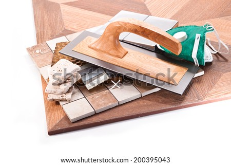 Tile floor oversized, marble and stone, mask, trowel on a white background - stock photo