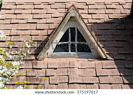 tile roof with triangle window - stock photo
