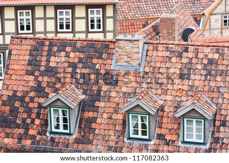 Tiled red roofs and dormers of Quedlinburg, Germany - stock photo
