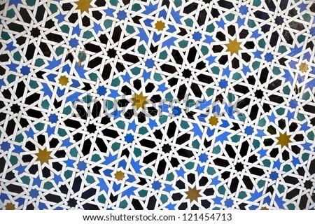 Tiled wall. Mosaics. Moorish Tiles. Glazed tiles on a wall in the Alcazar of Seville, Spain. Detail of wall mosaics in the Reales Alcazares of Sevilla, Spain. - stock photo