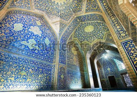 Tiled walls of masterpiece corridor of historical persian Sheikh Lutfollah Mosque in Isfahan, Iran. Masjed-e Sheikh Lotfollah built in 1619 for powerful king Shah Abbas.  - stock photo