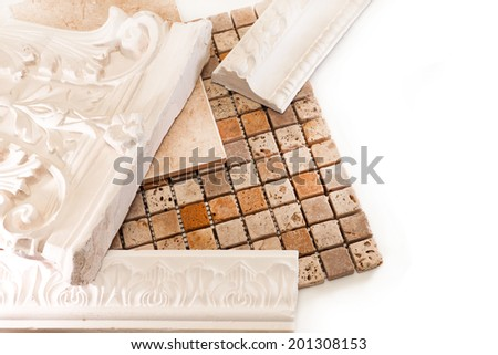 Tiles and plaster moldings to decorate the walls - stock photo