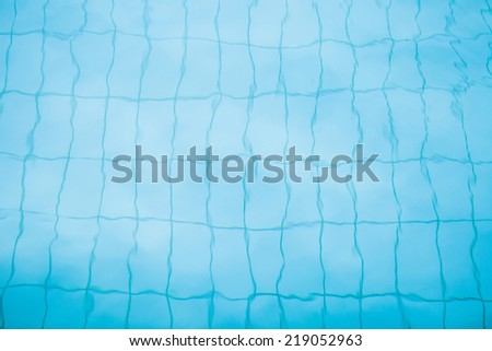 Tiles on bottom of swimming pool distorted slightly by water for background image - stock photo