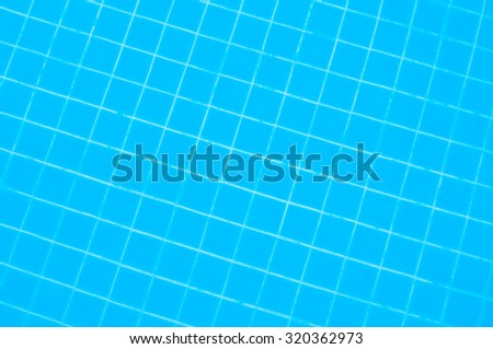 Tiles on swimming pool ground - stock photo
