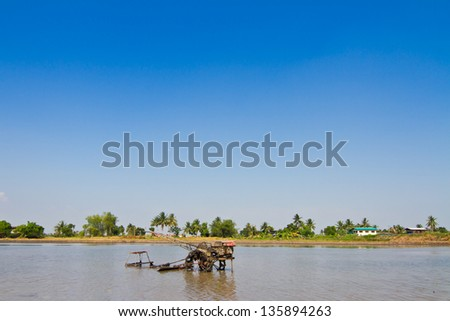 Tilling tractor - stock photo