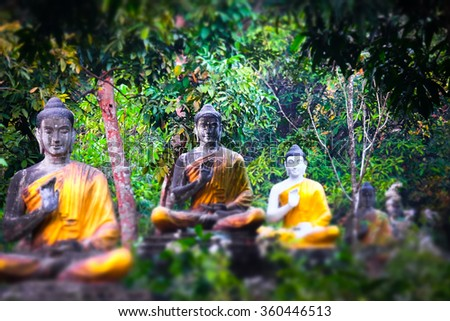Tilt shift blur effect. Amazing view of lot Buddhas statues in Loumani Buddha Garden. Hpa-An, Myanmar (Burma) travel landscapes and destinations - stock photo